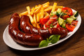 Grilled Sausages, Chips And Vegetable Salad Royalty Free Stock Photos - 37240648