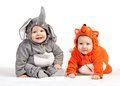 Two Baby Boys Dressed In Animal Costumes On White Royalty Free Stock Image - 37251596