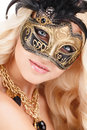 Portrait Of Beautiful Young Blonde Woman In Black And Gold Mysterious Venetian Mask. Fashion Photo On White Background Royalty Free Stock Image - 37281266