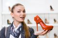 Woman Keeping Orange Leather Pump Stock Photos - 37345073