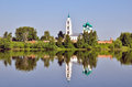 Cathedral With Bell Tower And His Reflection In Water Royalty Free Stock Images - 37347779