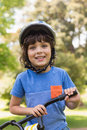 Cute Little Boy Wearing Bicycle Helmet Royalty Free Stock Photography - 37375257