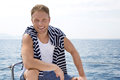 Portrait Of Blond Handsome Young Man On Sailing Boat. Royalty Free Stock Photography - 37384687