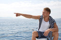 Blond Handsome Young Man On A Sailing Boat Pointing At Something Royalty Free Stock Photos - 37384788