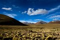 Desert And Mountain Over Blue Sky And White Clouds On Altiplano,Bolivia Stock Photos - 37413933