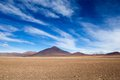 Desert And Mountain Over Blue Sky And White Clouds On Altiplano,Bolivia Stock Photos - 37415473