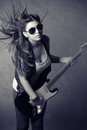 Beautiful Young Woman Wearing Sunglasses With Guitar Stock Photography - 37430222