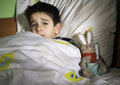 Sick Child In Bed With Teddy Bear Royalty Free Stock Photos - 37433278