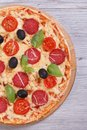 Pizza With Salami, Tomato, Cheese, Olives And Basil Close-up Stock Photos - 37440193