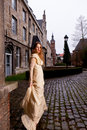 Woman In Victorian Dress In A Old City Square In The Evening In Profile Stock Photo - 37447670