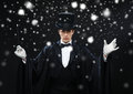 Magician In Top Hat With Magic Wand Showing Trick Stock Photo - 37458600