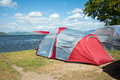 Tents On A Camping Site Near A Lake Royalty Free Stock Images - 37478589