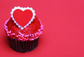Chocolate Cupcake With Red Heart On The Top, Over Red Background Royalty Free Stock Photo - 37481795