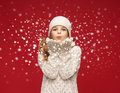 Happy Girl In Winter Clothes Blowing On Palms Royalty Free Stock Photography - 37493587