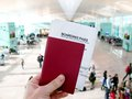 Passport And Boarding Pass, Waiting For A Flight In An Airport Royalty Free Stock Photo - 37508675
