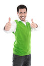 Happy Young Man Isolated In A Green Shirt And Thumbs Up. Royalty Free Stock Image - 37517316
