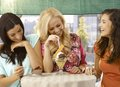 Happy Girls At Outdoor Cafe Smiling Stock Image - 37517931