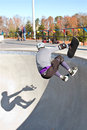 Skateboarder And Shadow Wipe Out In Big Bowl Stock Photos - 37526973