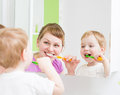Happy Mother And Child Teeth Brushing  In Bathroom Stock Images - 37528714