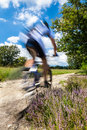 Cyclist In Blurred Motion Stock Photography - 37535862