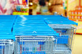 Rows Of Supermarket Shopping Cart Trolleys Royalty Free Stock Photo - 37544725