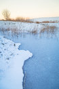 Winter Sunset Over Frozen Pond Stock Photography - 37610932