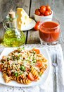 Whole Wheat Fusilli Pasta With Cheese And Cherry Tomatoes Stock Image - 37611101