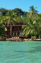 Tropical Seaside House With Dock And Lounger Royalty Free Stock Images - 37613939