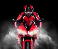 Motorcyclist In Red Equipment Stock Photos - 37654823