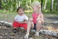 Summer In The Woods On Birch Logs Sits Two Little Sisters Stock Photography - 37655162
