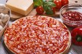 Basis For Pizza With Tomato Sauce And Ingredients Royalty Free Stock Image - 37670686