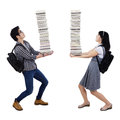 Young Couple Carrying A Pile Of Books Royalty Free Stock Photos - 37674228