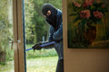 Burglar Behind Window Royalty Free Stock Photos - 37686938