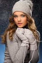 Cute Curly Girl Wearing Mittens During Snowfall Royalty Free Stock Image - 37694916