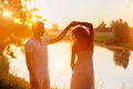 Young Couple In White Dancing On The Background Of Sunset Royalty Free Stock Photos - 37695258
