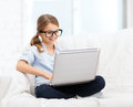 Smiling Girl In Specs With Laptop Computer At Home Royalty Free Stock Photography - 37707567