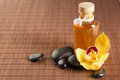 Essential Oil, Massage Stones And Orchid Flower Royalty Free Stock Image - 37712726