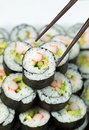 Chops Picking Up Single California Roll Stock Photography - 37719432