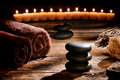 Black Polished Massage Stones Cairn In Rustic Spa Royalty Free Stock Photo - 37721705