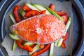 Cooking Raw Steak Of Red Fish Salmon On Vegetables, Zucchini Royalty Free Stock Photography - 37745197