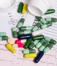 Colorful Pills And Capsules With Analysis Background Royalty Free Stock Images - 37756139