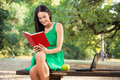 Beautiful Young Woman With Toothy Smile Reading Book In The Park Royalty Free Stock Image - 37758836