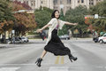 Asian Woman In Lifestyle Locations Crossing The Street Street In Front Of Capital Building In Austin, Texas Royalty Free Stock Image - 37758976