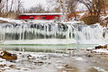 Red Covered Bridge And Frozen Waterfall Royalty Free Stock Image - 37764686