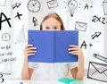 Girl Studying And Reading Book At School Stock Photography - 37771922