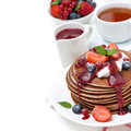 Breakfast With Pancakes With Cream, Fruit Sauce And Berries Stock Photography - 37774772