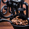 Vintage Manual Coffee Grinder With Coffee Beans On Wooden Brown Royalty Free Stock Photography - 37783087
