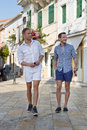Two Handsome Men Walking Through The City. Stock Images - 37798184