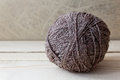 Brown Ball Of Yarn On A Wooden Table Over Vintage Wallpaper Royalty Free Stock Images - 37805929