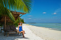 Woman In Blue Dress On A Beach At Maldives Royalty Free Stock Image - 37813396